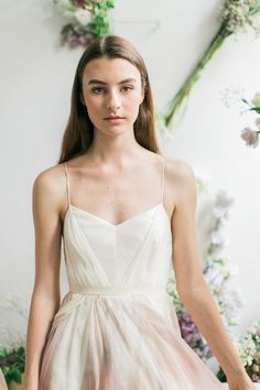 Leanne Marshall thin strapped wedding dress with slight pink colors and swishing skirts // We're still dreaming of these refreshing New York Bridal Fashion Week finds from Alexandra Grecco, CHRISTOS BRIDAL, Leanne Marshall and Limor Rosen Bridal Couture! Like your favs, Wedding Scoopers! // : Sophie Kaye Photography for The Wedding Scoop