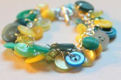 Learn how to make a bracelet that is both unique and adorable with this Buttons as Charms DIY Bracelet tutorial. This fabulous DIY jewelry tutorial comes with a clear and easy-to-follow video that will have you wearing your DIY bracelet in no time.