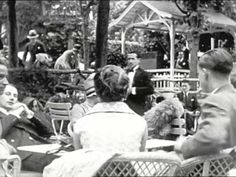 Edited and Titled by Burton Holmes.  Burton Holmes looking out over Paris square. VS square and traffic Avenue de l'Opera Sidewalk Cafe de la Paix Scenes on Boulevard; pedestrian…