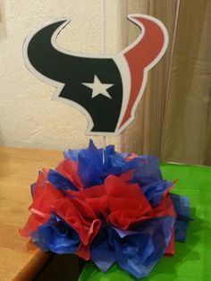 Texans centerpiece. Very easy to make. Just need foam and added tissue paper! :) I made this for my brothers party