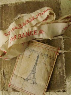 Parisian textile    love the ribbon and the faded textile