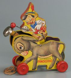 111.3833: Fisher Price Plucky Pinocchio (No. 494) | pull toy | Baby and Toddler Toys | Toys | National Museum of Play Online Collections | The Strong