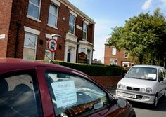 Roadside car traders have been accused of blocking access to a doctors' surgery for disabled and elderly patients.