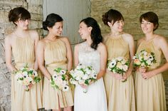 pretty shade of gold by http://usa.frenchconnection.com/ for these Bridesmaids Photography by Laura Ivanova Photography / lauraivanova.com, Event Planning by Premier Planning Services, Inc / premierplanningservices.com, Floral Design by Summer Harsh Botanical Artistry / summerharshbotanicalartistry.com/