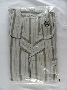 They are brown white striped. It is a size Ex Large. 100% Cotton. It is made by The F.L. Collection.
