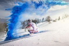 Blue eruption! The coloured powder was flung across the slopes as the talented skier went ...