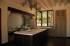 Santa Barbara Tower-House by Architect Jeff Shelton. Kitchen with wonderful cabinet stylling reflecting Spanish Revival influences. Love the refrigerator cabinet.