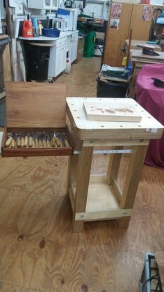 Woodcarving bench with extending shelf for tools