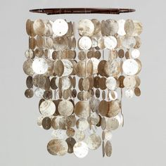 One of my favorite discoveries at WorldMarket.com: 8' Coffee Capiz Hanging Pendant Lantern  Ocean Nursery ... mobile? $20!