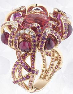 Ring in pink gold, rubies, pink sapphires, diamonds, drops of red tourmaline, set with a round faceted pink tourmaline