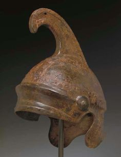 A GREEK IRON HELMET OF ATTIC TYPE CLASSICAL PERIOD, CIRCA 5TH CENTURY B.C.E.