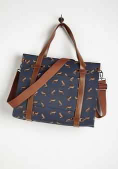 Camp Director Tote in Foxes. When the cabins shutter up for the season, take a bit of camp charm with you by packing your essentials in this rustically refined tote! #blue #modcloth