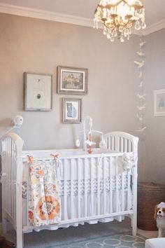 A #neutral #nursery is the perfect place for bright patterned #curtains and blankets.