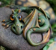 Cute dragon on a rock. Possibly made of Fimo and painted.