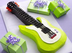 Caleb's next birthday cake???    Rock Star Birthday Party    Here's a party that rocks. Music is the centerpiece of activities and our Electric Guitar Cake is a showstopper. The birthday girl or boy will have fun with their favorite tunes, enjoy trivia games and eat some great food. Sit back and enjoy the show