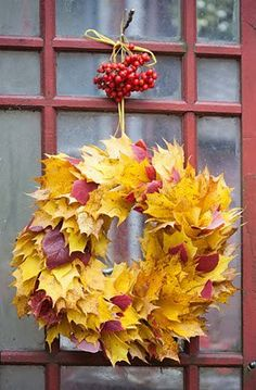 LOVE the cluster of berries used as the hanging spot for the nail to hold up the wreath -- great extra touch!