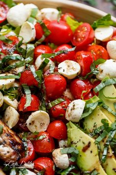 Balsamic Chicken Avocado Caprese Salad is a quick and easy meal in a salad! Seared chicken, fresh mozzarella and tomato halves, creamy avocado slices and shredded basil leaves are drizzled with an incredible balsamic dressing that doubles as a marinade for the ultimate salad!!