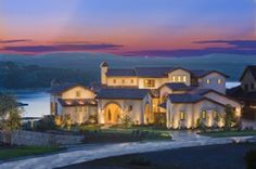 Winner of five awards in the Rough Hollow Parade of Homes, this 6,778 square foot home is an exquisite addition to the prestigious Lakeway neighborhood.