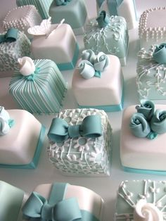 wedding petit fours - all the guests get a small cake at their seat. I want a small two tier cake and these for everyone else