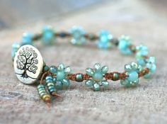 Micro macrame bracelet made with sparkly sea foam green crystals and amazonite gemstones. Natural brown waxed cord is used for the base cord. A tree of life button added for the closure.
