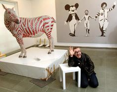 Damien Hirst with some of his exhibits