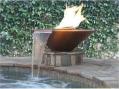 Bronze/Copper Fire & Water feature to replace cracked cement wok fountains at pool. Not quite sure about the shape, might be a tad too modern. But, we do have gas in the backyard, so something like this would be totally doable. :) (http://www.grandeffectsinc.com/component/phocagallery/category/8-fire-a-water-bowls) #pinmydreambackyard