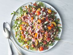 BLT Farro Salad | This veggie-forward dinner is easy to make, low on meat, and comes together in just 25 minutes. All it takes is a little bit of center-cut bacon to add big flavor. Whole-grain farro and cannellini beans team up to deliver a bounty of fiber; ripe summer tomatoes and squash add a pop of color and plenty of vitamins A and C. Double the recipe for the marinated onions and stash the extras in your fridge for a week; they're a great way to add a punch of flavor to simple sides,