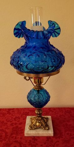 Fenton Colonial Blue Glass GWTW/Student Lamp With Poppy Pattern. Antique Oil Lamps, Antique Lighting, Vintage Lamps, Vintage Glassware, Vintage Decor, Fenton Lamps, Poppy Pattern, Hurricane Lamps, Let Your Light Shine