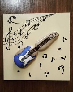 Love this picture of painted rocks that look like a guitar. Great gift for a musician. Pebble Stone, Pebble Art, Stone Art, Stone Crafts, Rock Crafts, Hobbies And Crafts, Arts And Crafts, Istanbul, Pebble Pictures
