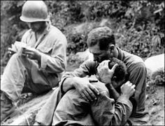 """This photo by Al Chang from the Korean War was included in the book """"Family of Man"""" by Edward Steichen, published in 1955. Al Chang was a combat photographer."""
