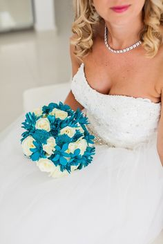Teal blue and white wedding bouquet by MOMENTS www.weddingincrete.com