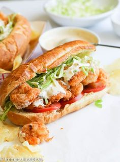 Shrimp po' boy sandwich - Immaculate Bites Shrimp po' boy sandwich- Crispy Crunchy shrimp piled mile high on buttered toasted French roll, stuffed with crunchy cabbage, Fresh tomatoes - drizzled with a lip smacking remoulade sauce . Po Boy Sandwich, Shrimp Sandwich, Chicken Sandwich, Shrimp Recipes, Fish Recipes, Sauce Rémoulade, Hot Sauce, Shrimp Po Boy, Snacks