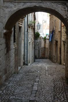 Picture of Cobble stone street with arch in the old town of Dubrovnik (Dubrovnik, Croatia)