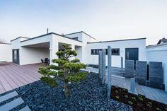 Voici 7 jardins de façade qui vous inspireront pour renouveler votre propre façade de maison!