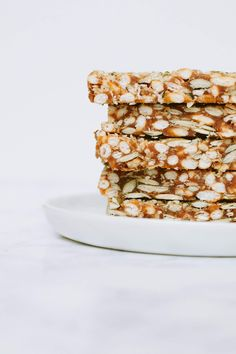 Sweet, chewy, salty, seedy. These vegan, gluten-free puffed rice and seed bars are a healthy snack/healthy granola bar full of healthy real food ingredients. Naturally sweetened only with dates.
