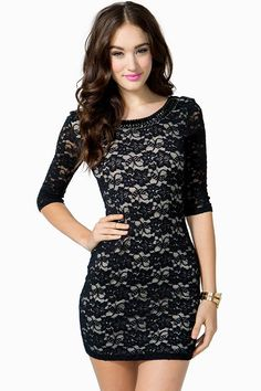Sinfully sweet lace bodycon dress featuring black cab stone embellishments along the necklace and deep U scoop back. Half sleeves. Lace overlay. Short length. Throw on some sky-high Mary Jane pumps and you're ready for a night on the town.