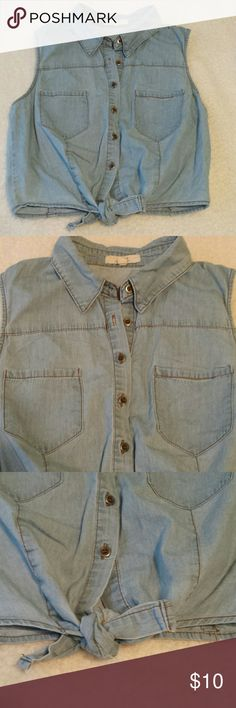 Denim / Chambray Button Down Top. Size Small. Cute chambray / denim / jean / sleeveless button down that ties at the bottom hem. It's made that way and can't be untied to wear it like a regular top. Tag says size Medium but it definitely fits more like a size Small. Iris Los Angeles  Tops Button Down Shirts