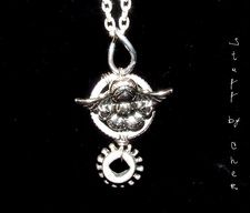 Angel Pendant   Take an angel along for every ride. The angel charm is mounted on a pair of wire wrapped gears.    $20
