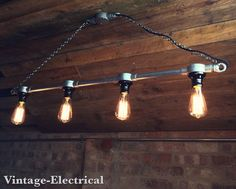 Hanging Industrial Steampunk style light by VintageElectrical