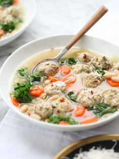Skinny Slow Cooker Kale and Turkey Meatball Soup - a healthy version of Italian Wedding Soup...