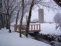 Snow. Creek and silos.