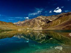 Lake of the Moon, India  The azure waters of Chandra Tal - Lake of the Moon - in Himachal Pradesh, India, reflect the vivid hues of a bright Himalayan day.