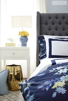 Classic white + navy hotel chic bedding is so gorgeous paired with this navy chinoiserie duvet and shams for a rich and elegant look in our bedroom. #bedroom #bedding #chinoiserie