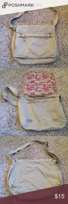 Cotton Messenger Crossbody Bag Pre-loved, great condition! Only a couple small marks from normal wear and tear, and another small stain (may come out - pictured). Velcro closure and exterior pocket. Sturdy strap. Washable. Accent panel inside flap. Bags Crossbody Bags