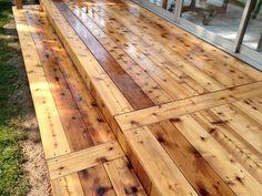 Deck restoration by: J&H Painting on a cedar deck, after deck wash & brightener.