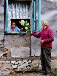 He brings her flowers, can't help but be happy that love has no age...