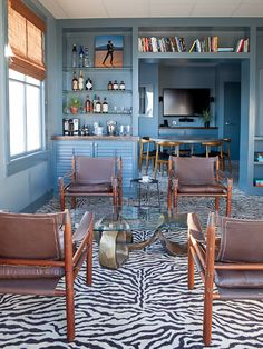 We've tapped the top interior designers to share their insider secrets, tips, and advice to create a chic, cool, and cozy living room you'll want to hang out in. Top Interior Designers, Interior Design Studio, Cozy Living Rooms, Living Spaces, Mid Century Leather Chair, Animal Print Decor, Indian Room, Guest Room Office, Blue Rooms