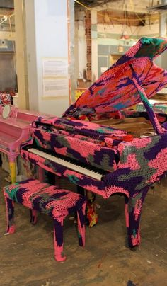 NICE!! Yarn bombed baby grand piano    crochet covered grand piano by Olek....this is just not pretty but needed to be pinned because of the work it took to do this!
