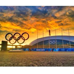 A vivid sun sets behind Olympic Park in Sochi, Russia. The Opening Ceremony is Friday. #sochi #olympicrings #olympics (Image: @nbcnewscrew / NBC News)