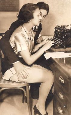 Woman distracted while writing on typewriter.Biederer Studio.Jacques Biederer (1887-1942),Charles Biederer (1892-1942). In 1908 Jacques Biederer, a Czech immigrant, moved to Paris and set up a photography studio.Jacques' earliest known photographs are of nudes in classical poses which were typical of that era. Over time his compositions became more contemporary. He began to shoot outdoors and created photo-sets that told a simple story, such as a romantic couple cavorting in a park.